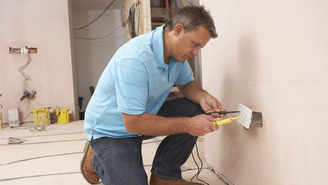 one of our team testing a socket at a domestic premises